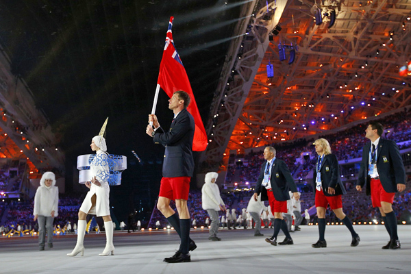 Bermuda's flag-bearer Murphy leads his country's delegation during the opening ceremony of the 2014 Sochi Winter Olympic Games at Fisht stadium