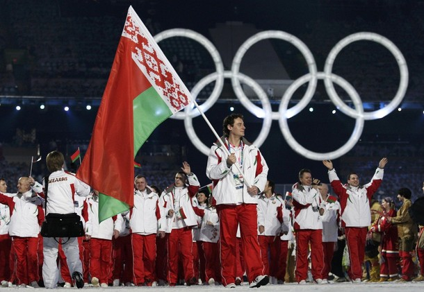Oleg Antonenko of Belarus carries his country's flag during the opening ceremony of the Vancouver 2010 Winter Olympics