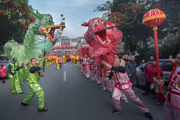 People perform dragon dance to celebrate China's Lunar New Year in Dabu County