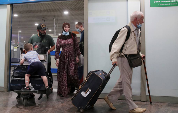 Russian evacuees arrive on repatriation flight to Moscow from Africa